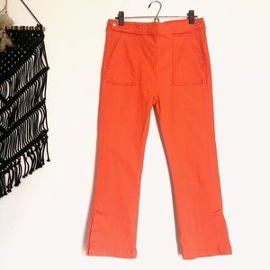 Bright orange cropped flare pants